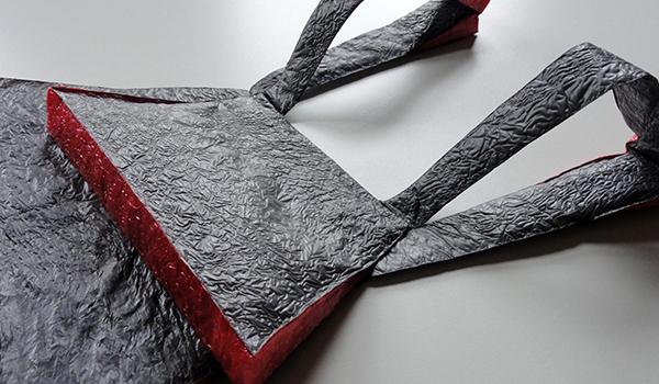 "Deflate 3, reused plastic bags, plastic, 22"" x 8 1/2"" x 1"", 2015"